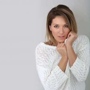 Woman Pulling Sweater Up to Her Cheeks