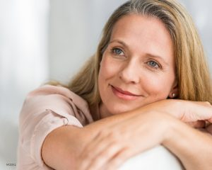 Older Woman with Blue Eyes Resting Head Copy