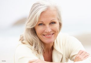 Smiling Mature Woman in Beige Sweater