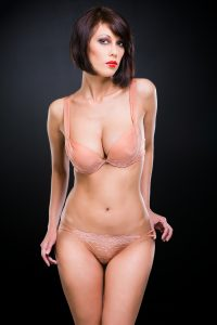 Woman with Short Brown Hair with Red Lipstick in Lingerie